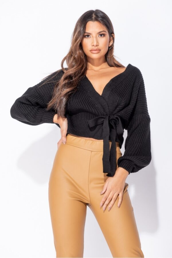 """shop """"Shop black coloured wrap front belted puff sleeve cropped cardigans at Amora Shopping and get your hands on this season's best knitwear and loungewear. This wrap front belted puff sleeve cropped cardigan looks great pair of skinny jeans"""