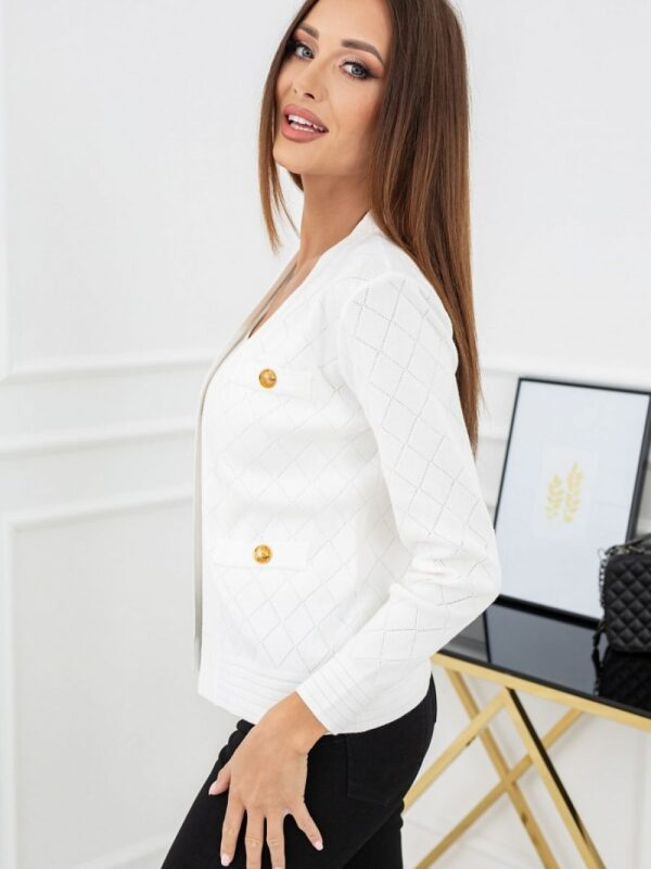 stylish cardigan decorated with golden buttons. Made of high-quality