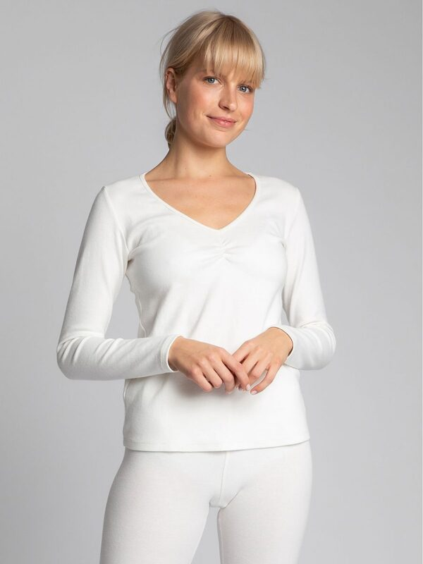 Shop The capsule wardrobe consists of such elements as this smooth cotton blouse with long sleeves