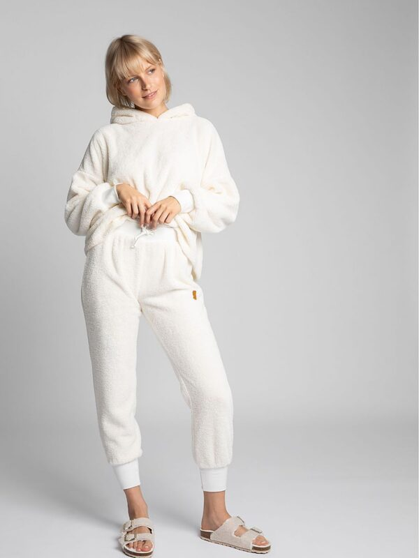 Shop Heavenly light joggers made of plush knit will make lazy moments at home more pleasant and will prove themselves during a walk when it's cold outside. at www.amora-shopping.com