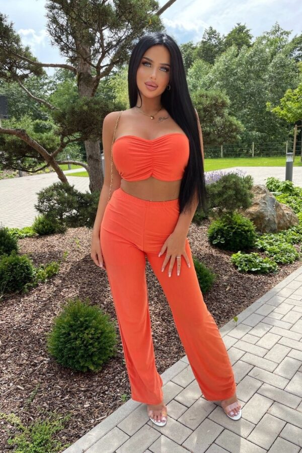 Shop Orange Slinky Halterneck Crop Top & Wide Leg Trousers at Amora Shopping. Shop perfect pairs- co-ordinating outfits is seriously in right now